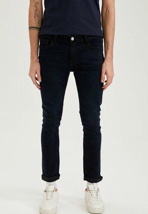 PEDRO-SLIM FIT TRACKSUIT BOTTOMS - Slim fit jeans - indigo
