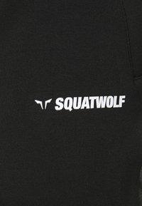 SQUATWOLF - WARRIOR SHORTS - Sports shorts - black - 4