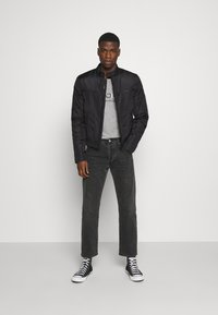 Calvin Klein Jeans - PADDED MOTO JACKET - Light jacket - black - 1