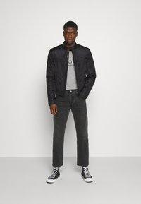 Calvin Klein Jeans - PADDED MOTO JACKET - Kurtka przejściowa - black - 1