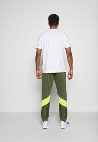 adidas Performance - PANT - Tracksuit bottoms - khaki - 2