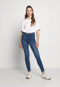 JDY - JDYPOLLI HIGH SUPER - Jeansy Skinny Fit - medium blue denim - 1