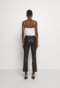Ibana - ESTELLE - Leather trousers - black - 2