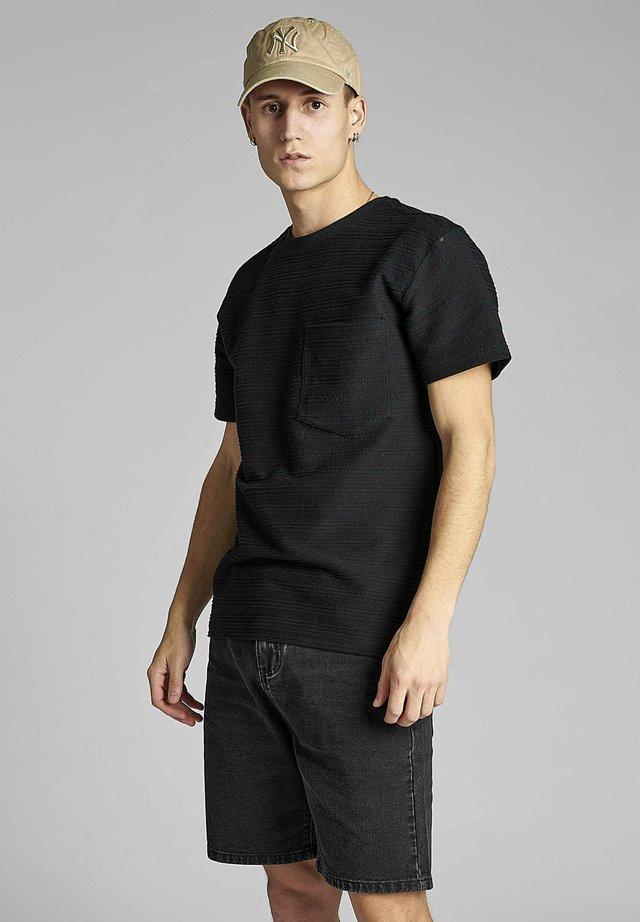 T-shirt con stampa - caviar
