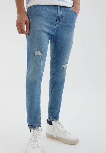 MIT ZIERRISSEN - Slim fit jeans - light blue
