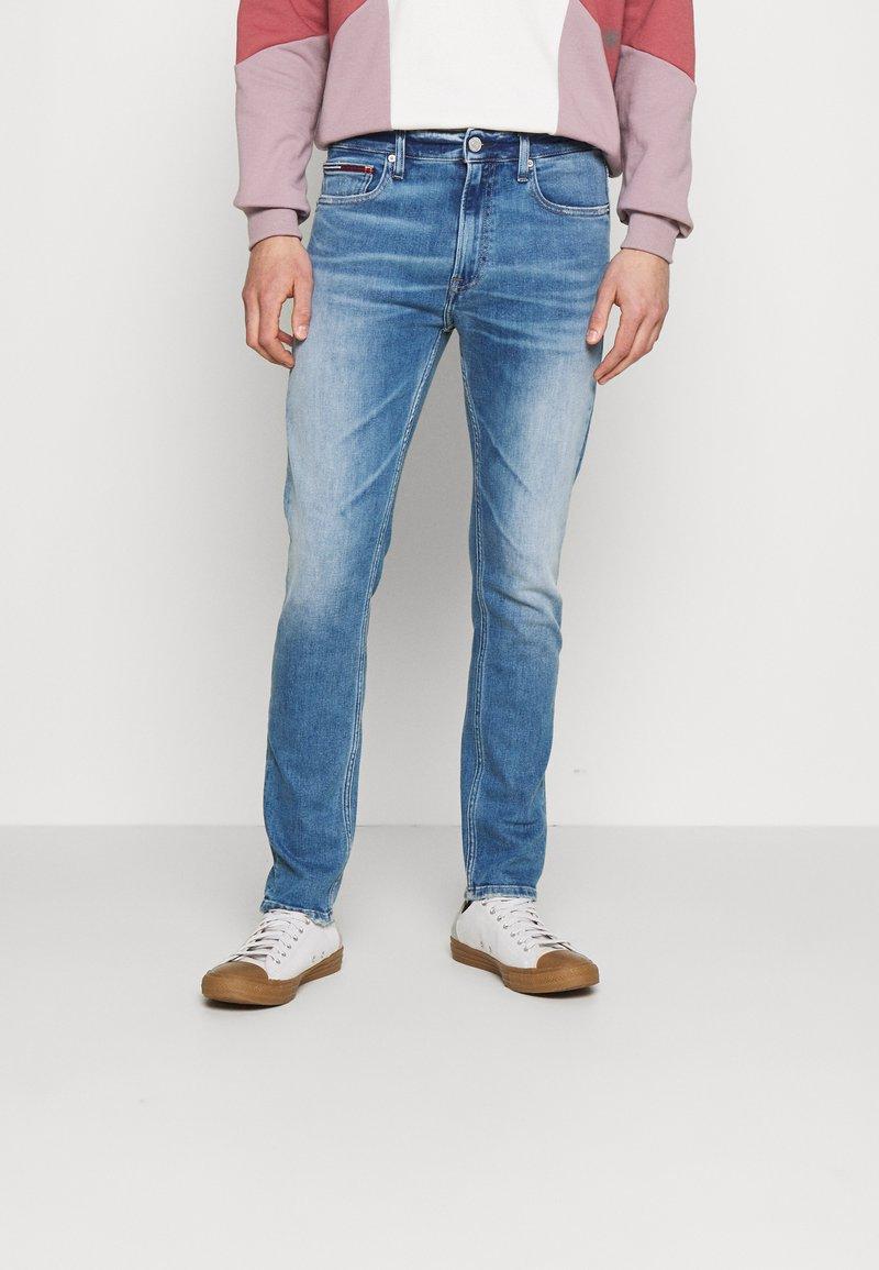 Tommy Jeans - SIMON SKINNY - Flared Jeans - denim
