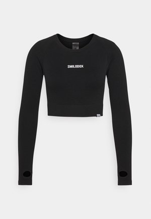 SEAMLESS CROPPED - Long sleeved top - schwarz