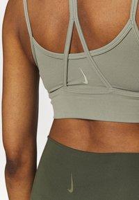 Nike Performance - INDY YOGA BRA - Light support sports bra - light army/light army/stone - 5