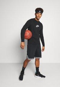 Nike Performance - TEE FREAK LONG SLEEVE - Long sleeved top - black - 1