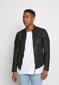 Tigha - CADAN - Leather jacket - black stone wash - 0