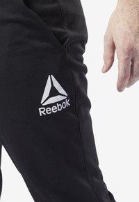 Reebok - TRAINING ESSENTIALS LOGO JOGGER PANTS - Tracksuit bottoms - black - 3