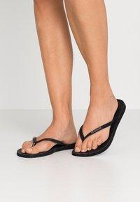 Havaianas - SLIM FIT SPARKLE - T-bar sandals - black - 3