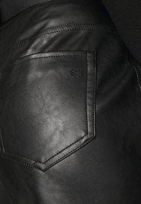 NIKKIE - MELLA PANTS - Trousers - black - 4