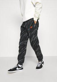 Nike Sportswear - PANT - Tracksuit bottoms - black/orange - 0