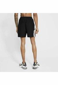 Nike Performance - RUN SHORT - Korte sportsbukser - black/white - 1