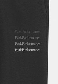 Peak Performance - GROUND UNISEX - Träningsbyxor - black - 2