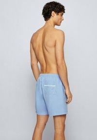 BOSS - DOLPHIN - Swimming shorts - open blue - 1