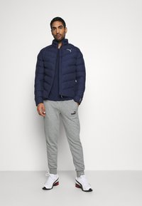Puma - WARMCELL LIGHTWEIGHT JACKET - Winter jacket - peacoat - 1