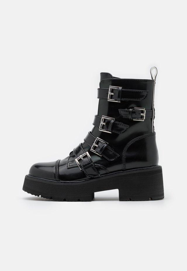 MOLLIE - Kotníkové boty na platformě - black