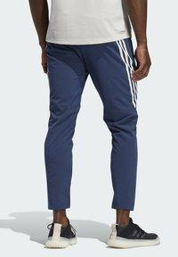 adidas Originals - AEROREADY STRIPES - Tracksuit bottoms - blue - 1