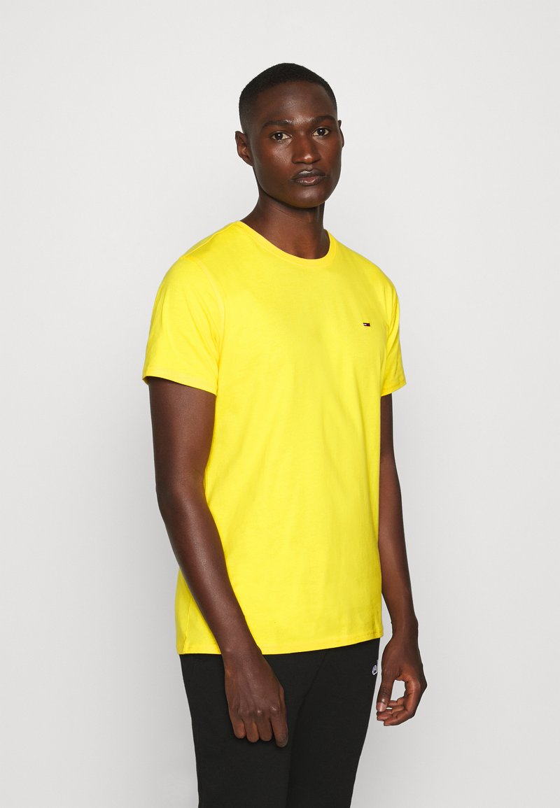 Tommy Jeans - ESSENTIAL SOLID TEE - Basic T-shirt - star fruit yellow