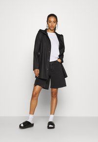 JDY - JDYSHELBY BELT RAINCOAT - Waterproof jacket - black - 1