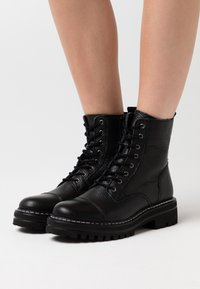 Steven New York - LAZZY - Platform ankle boots - black - 0