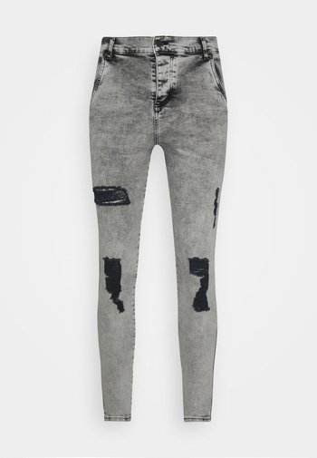 SKINNY FIT ACID WASH WITH DISTRESSING