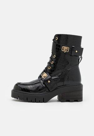 BOOT EYE LIKE - Enkellaarsjes met plateauzool - black