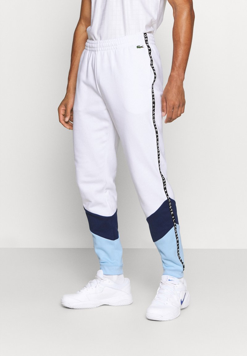 Lacoste Sport - PANT TAPERED - Träningsbyxor - white