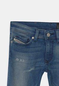 Diesel - SLEENKER UNISEX - Slim fit jeans - blue denim - 2