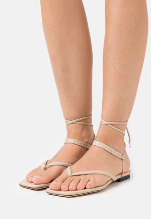RIVA - T-bar sandals - beige