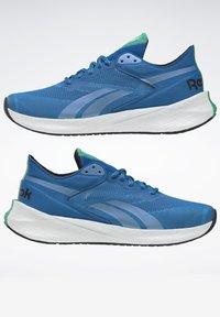Reebok - FLOATRIDE ENERGY SYMMETROS SHOES - Stabilty running shoes - blue - 5
