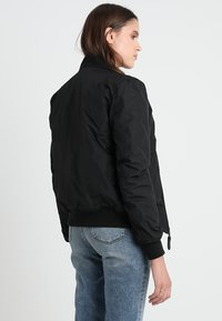 Alpha Industries - Light jacket - black - 3