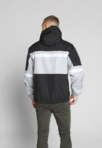 Nike Sportswear - M NSW NIKE AIR JKT WVN - Veste coupe-vent - smoke grey/black/white - 2