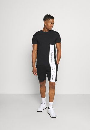 VERTICAL SCRIPT TWINSET - Trainingspak - black