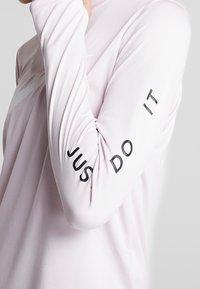 Nike Performance - MIDLAYER RUN - Sports shirt - barely rose/white - 5