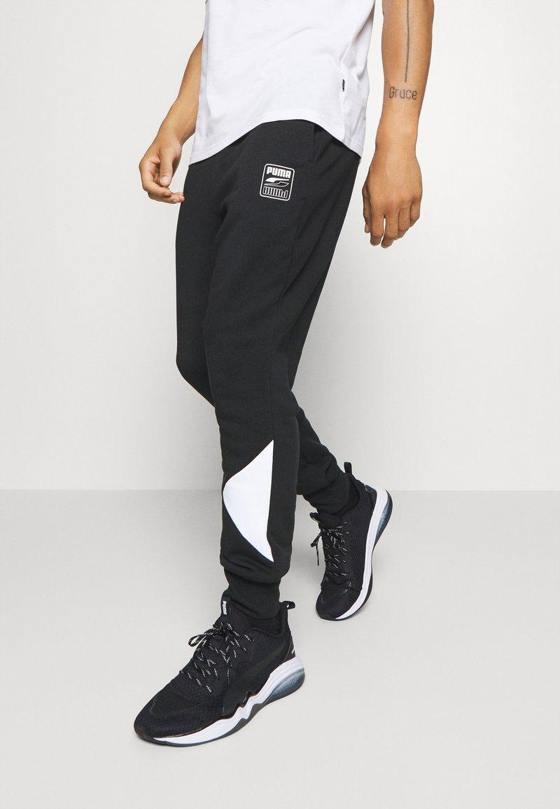 Puma - REBEL PANTS BLOCK - Tracksuit bottoms - black