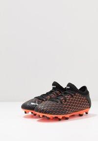 Puma - FUTURE 6.4 FG/AG - Moulded stud football boots - black/white/orange - 3