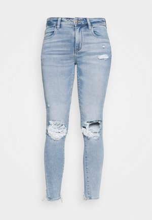 JEGGING - Slim fit jeans - busted bright