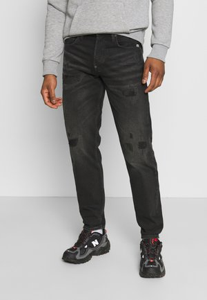 ALUM RELAXED TAPERED - Relaxed fit jeans - black