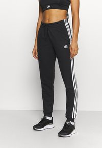 adidas Performance - ESSENTIALS FRENCH TERRY STRIPES PANTS - Pantaloni sportivi - black/white - 0