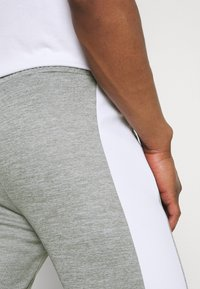Kings Will Dream - VESY MARL TAPE PANT - Tracksuit bottoms - grey - 5