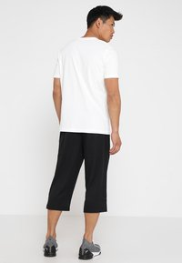 Puma - ACTIVE Pants - 3/4 sports trousers - puma black - 2