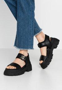 Buffalo - VEGAN JOJO - Platform sandals - black - 0