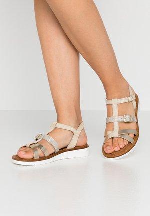 Sandaalit nilkkaremmillä - beige/light gold
