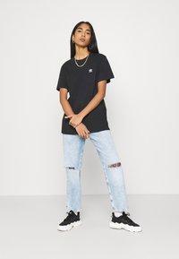 adidas Originals - LOOSE TEE - Print T-shirt - black - 1