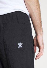 adidas Originals - ADICOLOR TREFOIL TRACK PANTS - Spodnie treningowe - black - 5
