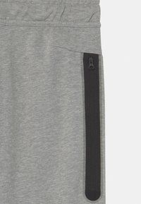 Nike Sportswear - Tracksuit bottoms - dark grey heather - 2