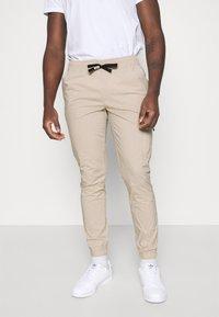 Tommy Jeans - SCANTON - Cargo trousers - beige - 0